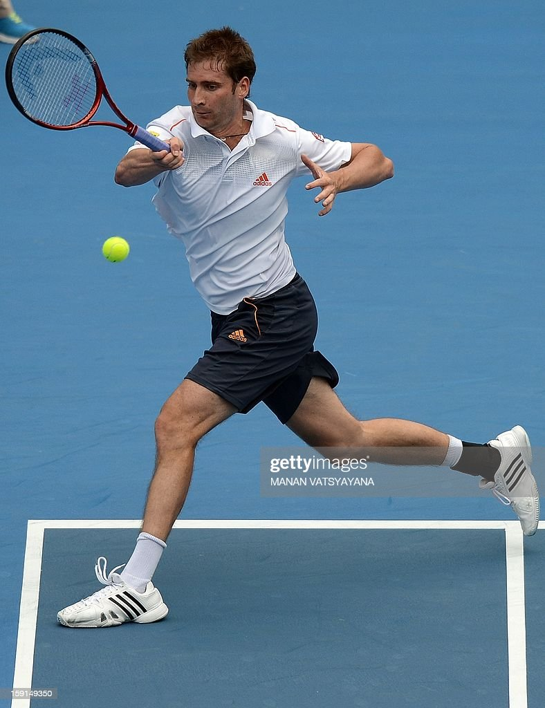 Florian Mayer of Germany returns a shot against Bernard Tomic of Australia during their second round match at the Sydney International tennis tournament on January 9, 2013. AFP PHOTO/ MANAN VATSYAYANA USE