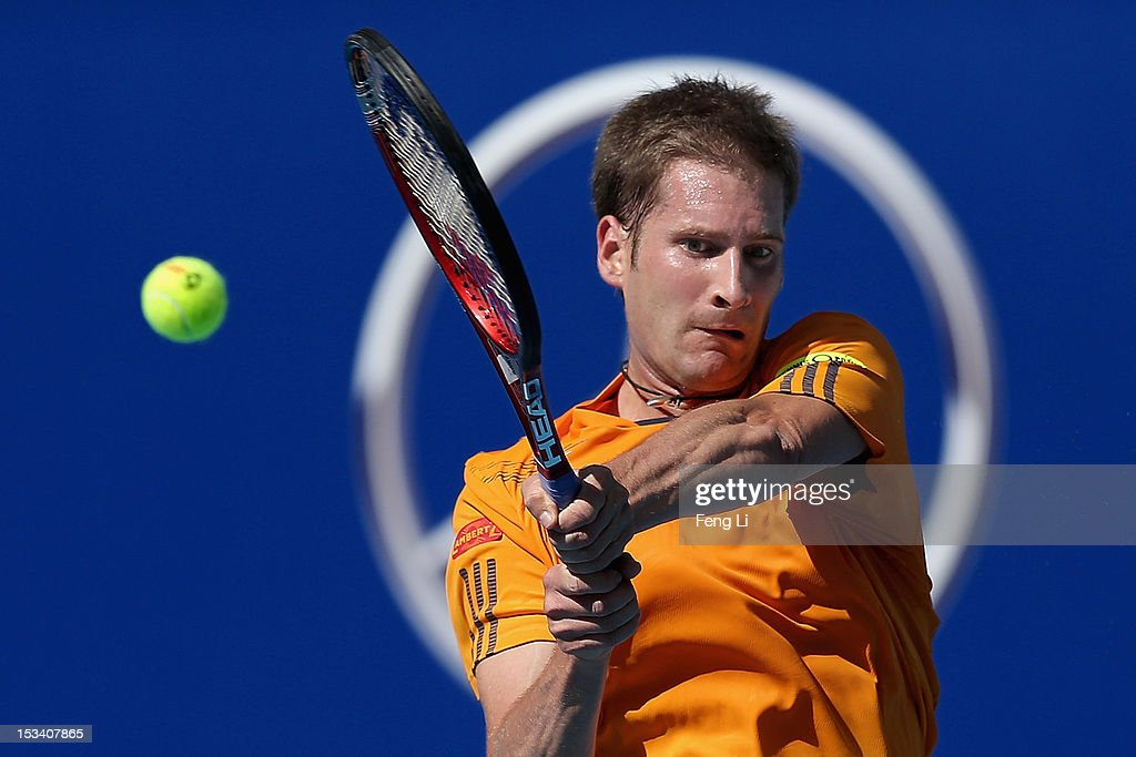 <a gi-track='captionPersonalityLinkClicked' href=/galleries/search?phrase=Florian+Mayer&family=editorial&specificpeople=206516 ng-click='$event.stopPropagation()'>Florian Mayer</a> of Germany returns a shot to Ze Zhang of China during the Day 7 of China Open at the China National Tennis Center on October 5, 2012 in Beijing, China.