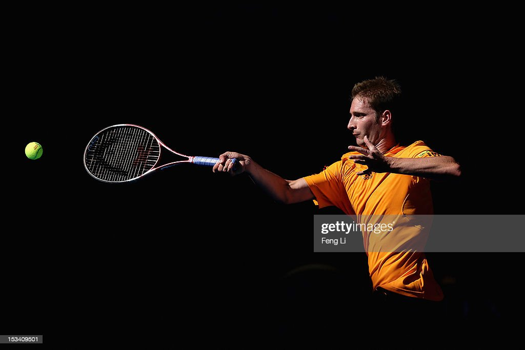 <a gi-track='captionPersonalityLinkClicked' href=/galleries/search?phrase=Florian+Mayer&family=editorial&specificpeople=206516 ng-click='$event.stopPropagation()'>Florian Mayer</a> of Germany returns a shot to Ze Zhang of China during the Men's Single Quarterfinal of China Open at the China National Tennis Center on October 5, 2012 in Beijing, China.