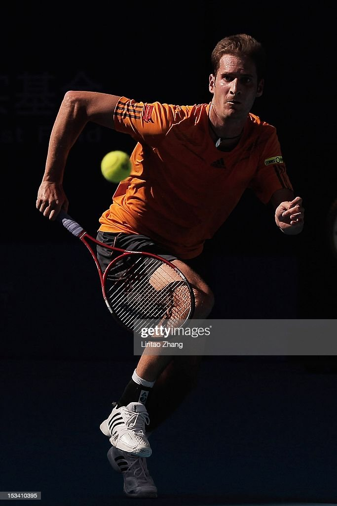 <a gi-track='captionPersonalityLinkClicked' href=/galleries/search?phrase=Florian+Mayer&family=editorial&specificpeople=206516 ng-click='$event.stopPropagation()'>Florian Mayer</a> of Germany returns a shot to Ze Zhang of China during the Quarterfinals of China Open at the China National Tennis Center on October 5, 2012 in Beijing, China.