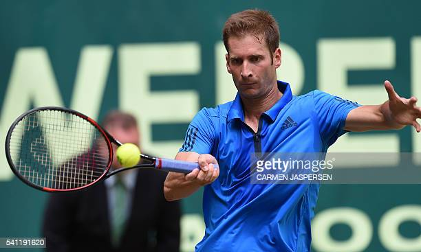Florian Mayer of Germany returns the ball to Alexander Zverev of Germany during the ATP tournament tennis final match in Halle western Germany on...