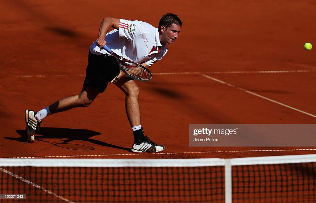 <a gi-track='captionPersonalityLinkClicked' href=/galleries/search?phrase=Florian+Mayer&family=editorial&specificpeople=206516 ng-click='$event.stopPropagation()'>Florian Mayer</a> of Germany returns the ball to Bernard Tomic of Australia during the Davis Cup World Group Play-Off match between Germany and Australia at Rothenbaum on September 16, 2012 in Hamburg, Germany.