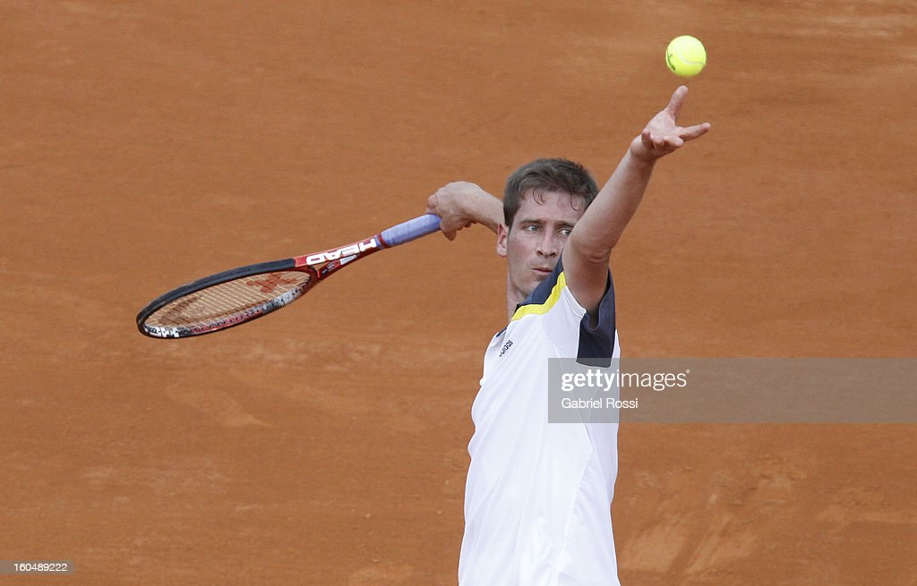 Florian Mayer of Germany serves during the match against Juan Monaco (not in frame) of Argentina between Argentina and Germany in the first round of Davis Cup at Parque Roca Stadium on February 01, 2013, Buenos Aires, Argentina.