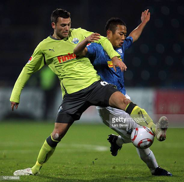 Florian Mohr of Paderborn challenges Chong Tese of Bochum during the Second Bundesliga match between VfL Bochum and SC Paderborn at Rewirpower...