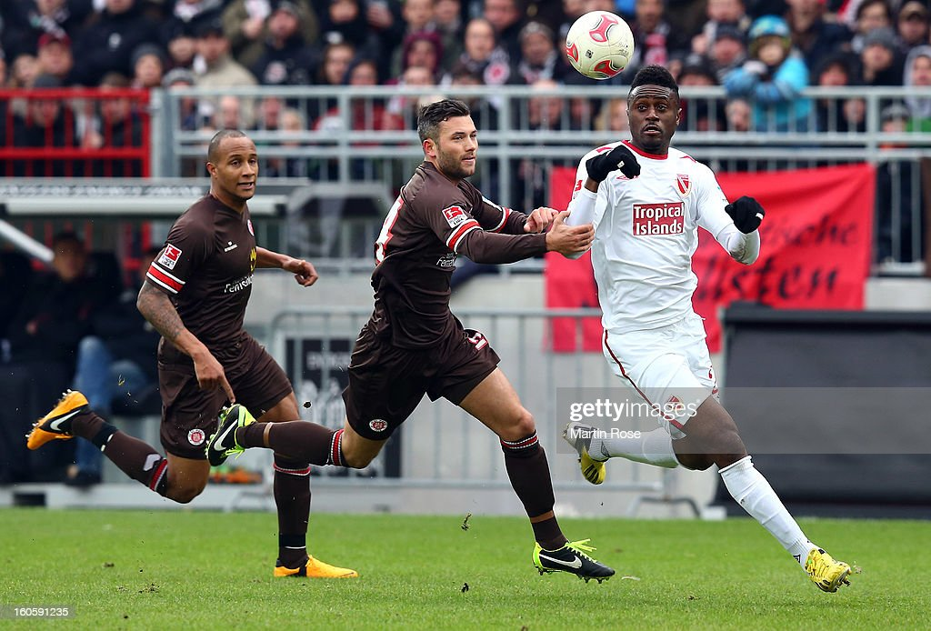 Florian Mohr (L) of St. Pauli and <a gi-track='captionPersonalityLinkClicked' href=/galleries/search?phrase=Boubacar+Sanogo&family=editorial&specificpeople=707643 ng-click='$event.stopPropagation()'>Boubacar Sanogo</a> (R) of Cottbus battle for the ball during the second Bundesliga match between FC St. Pauli and Energie Cottbus at Millerntor Stadium at Millerntor Stadium on February 3, 2013 in Hamburg, Germany.