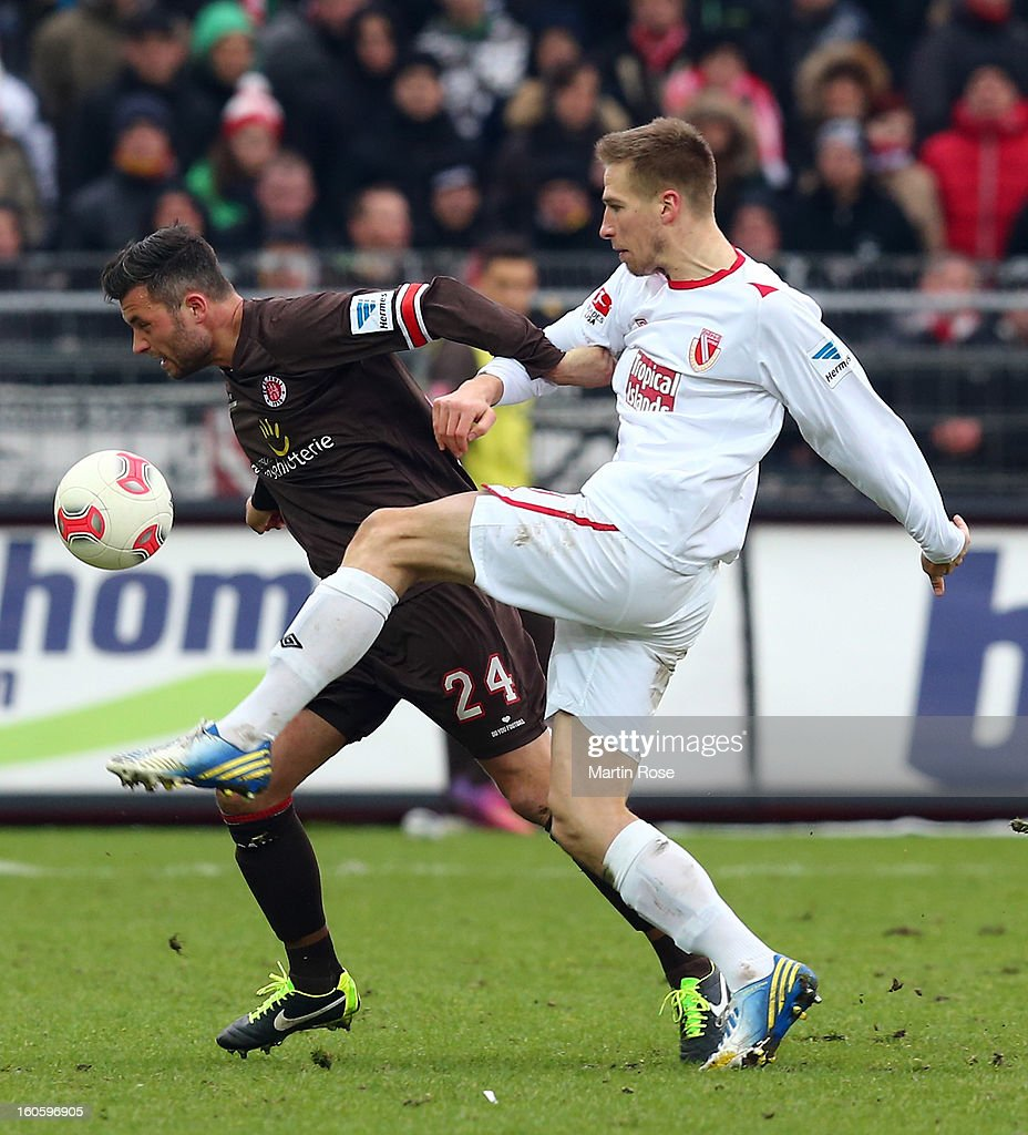 Florian Mohr (L) of St. Pauli and <a gi-track='captionPersonalityLinkClicked' href=/galleries/search?phrase=Marco+Stiepermann&family=editorial&specificpeople=3522227 ng-click='$event.stopPropagation()'>Marco Stiepermann</a> (R) of Cottbus battle for the ball during the second Bundesliga match between FC St. Pauli and Energie Cottbus at Millerntor Stadium at Millerntor Stadium on February 3, 2013 in Hamburg, Germany.