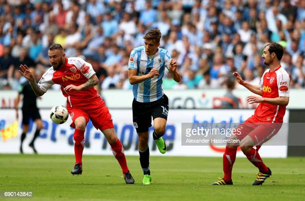 Florian Neuhaus of 1860 Muenchen and Marvin Knoll of Jahn Regensburg compete for the ball during the Second Bundesliga Playoff second leg match...