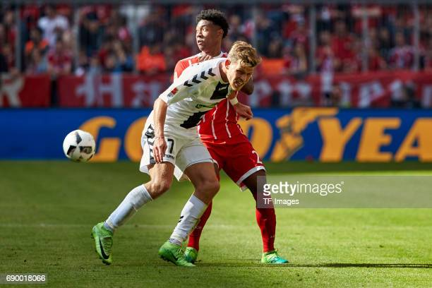 Florian Niederlechner of Freiburg and David Alaba of Bayern Muenchen battle for the ball during the Bundesliga match between Bayern Muenchen and SC...