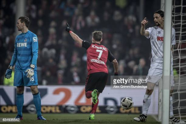 Florian Niederlechner of Freiburg celebrates after team mate Vincenzo Grifo scored his team's first goal during the Bundesliga match between SC...