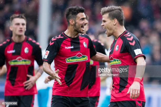Florian Niederlechner of Freiburg celebrates his team's second goal with team mate Onur Bulut during the Bundesliga match between SC Freiburg and FC...