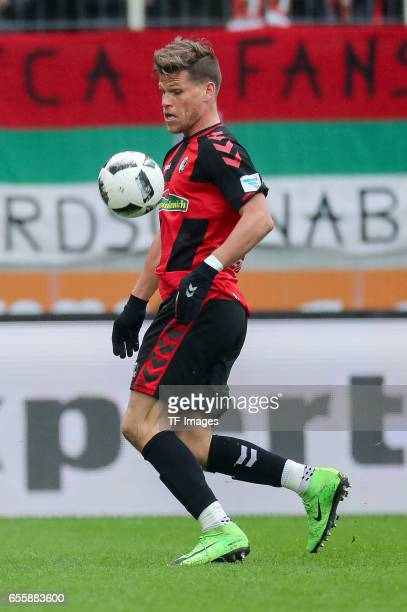 Florian Niederlechner of Freiburg controls the ball during the Bundesliga match between FC Augsburg and SC Freiburg at WWK Arena on March 18 2017 in...