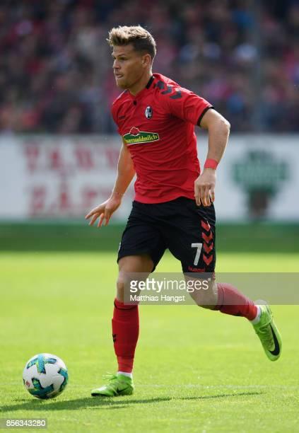 Florian Niederlechner of Freiburg controls the ball during the Bundesliga match between SportClub Freiburg and TSG 1899 Hoffenheim at...