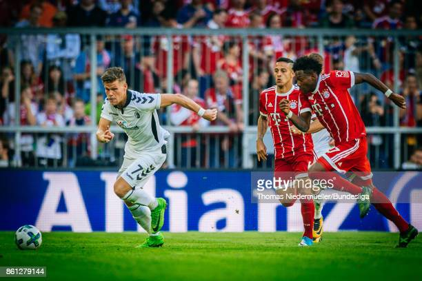 Florian Niederlechner of Freiburg fights for the ball with David Alaba of Bayern during the Bundesliga match between FC Bayern Muenchen and SportClub...