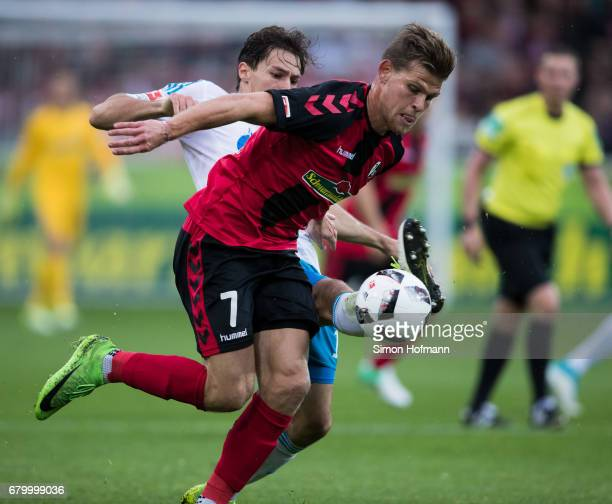 Florian Niederlechner of Freiburg is challenged by Benjamin Stambouli of Schalke during the Bundesliga match between SC Freiburg and FC Schalke 04 at...
