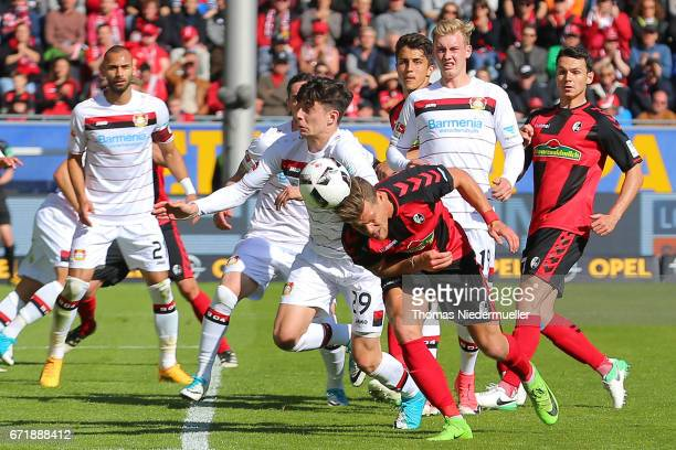 Florian Niederlechner of Freiburg jumps for a headder during the Bundesliga match between SC Freiburg and Bayer 04 Leverkusen at SchwarzwaldStadion...