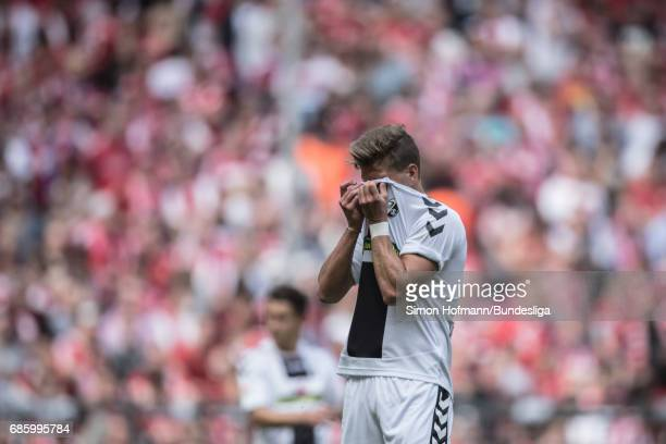 Florian Niederlechner of Freiburg reacts during the Bundesliga match between Bayern Muenchen and SC Freiburg at Allianz Arena on May 20 2017 in...