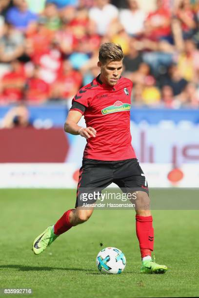 Florian Niederlechner of Freiburg runs with the ball during the Bundesliga match between SportClub Freiburg and Eintracht Frankfurt at...