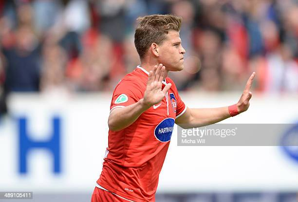 Florian Niederlechner of Heidenheim celebrates after scoring the opening/first goal during the Third League match between 1 FC Heidenheim and SpVgg...