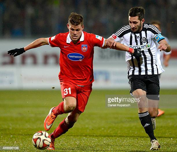 Florian Niederlechner of Heidenheim is challenged by Leandro Grech of Aalen during the second Bundesliga match between 1 FC Heidenheim and VfR Aalen...