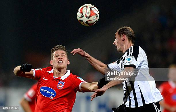 Florian Niederlechner of Heidenheim jumps for a header with Oliver Barth of Aalen during the second Bundesliga match between 1 FC Heidenheim and VfR...