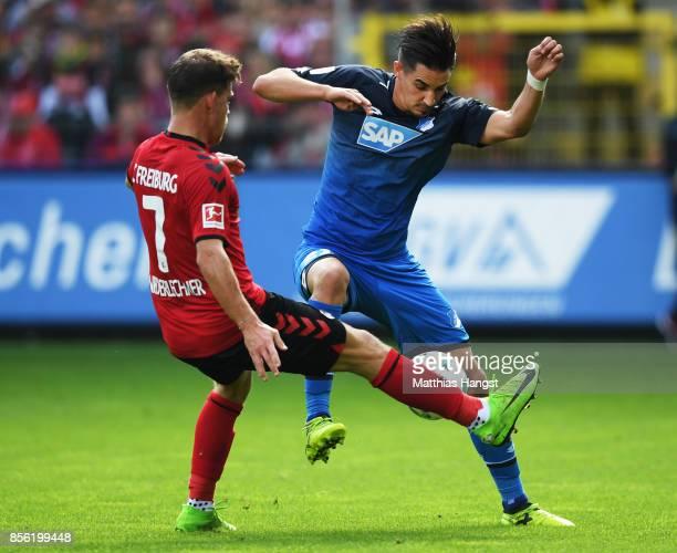 Florian Niederlechner of SC Freiburg challenges Benjamin Huebner of 1899 Hoffenheim during the Bundesliga match between SportClub Freiburg and TSG...