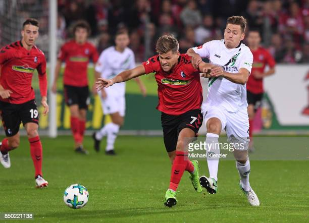 Florian Niederlechner of SC Freiburg challenges Waldemar Anton of Hannover 96 during the Bundesliga match between Sport Club Freiburg and Hannover 96...