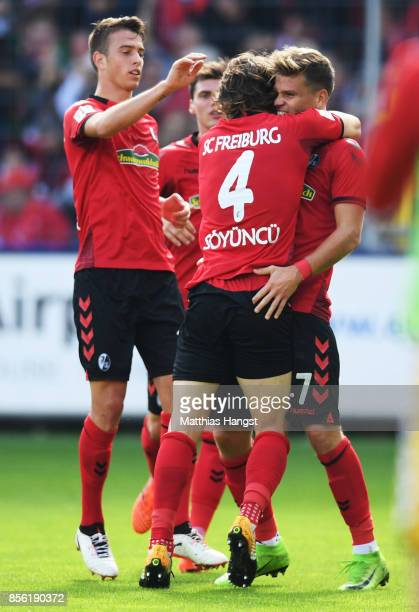 Florian Niederlechner of SC Freiburg is congratulated after scoring a goal during the Bundesliga match between SportClub Freiburg and TSG 1899...
