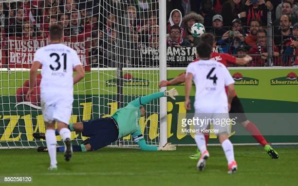 Florian Niederlechner of SC Freiburg missplay a Penalty against Goalkeeper Philipp Tschauner of Hannover 96 during the Bundesliga match between Sport...