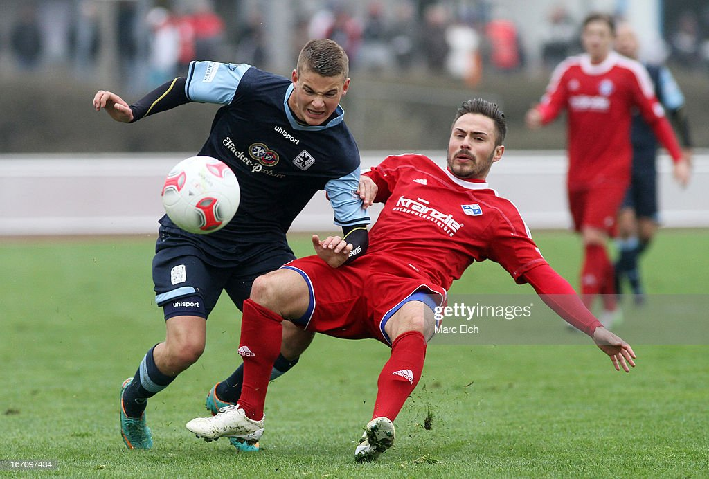 Florian Peruzzi of Illertissen (R) challenges Chris Wolf of Muenchen (L) during the Regionalliga Bayern match between FV Illertissen and 1860 Muenchen II at Voehlinstadion on April 20, 2013 in Illertissen, Germany.