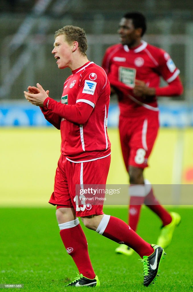 Florian Riedel (L) and Mohamadou Idrissou of Kaiserslautern celebrate a goal during the Second Bundesliga match between TSV 1860 Muenchen and 1. FC Kaiserslautern at Allianz Arena on February 4, 2013 in Munich, Germany.