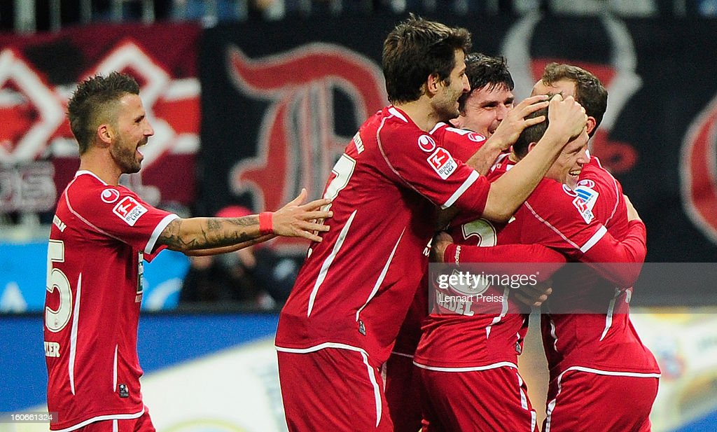 Florian Riedel (2nd R) of Kaiserslautern and his teammates celebrate a goal during the Second Bundesliga match between TSV 1860 Muenchen and 1. FC Kaiserslautern at Allianz Arena on February 4, 2013 in Munich, Germany.