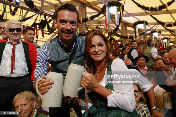 Florian Silbereisen and Andrea Berg attend the opening of the 2016 Oktoberfest beer festival at Theresienwiese on September 17 2016 in Munich Germany...