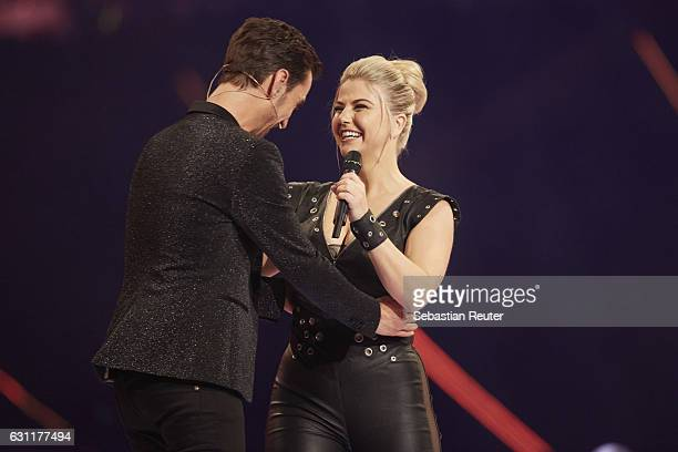 Florian Silbereisen and Beatrice Egli are seen on stage at the 'Das grosse Fest der Besten' tv show at Velodrom on January 7 2017 in Berlin Germany