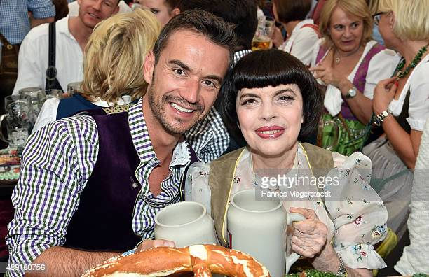 Florian Silbereisen and Mireille Mathieu pose at Schottenhamel beer tent during the Oktoberfest 2015 Opening at Theresienwiese on September 19 2015...