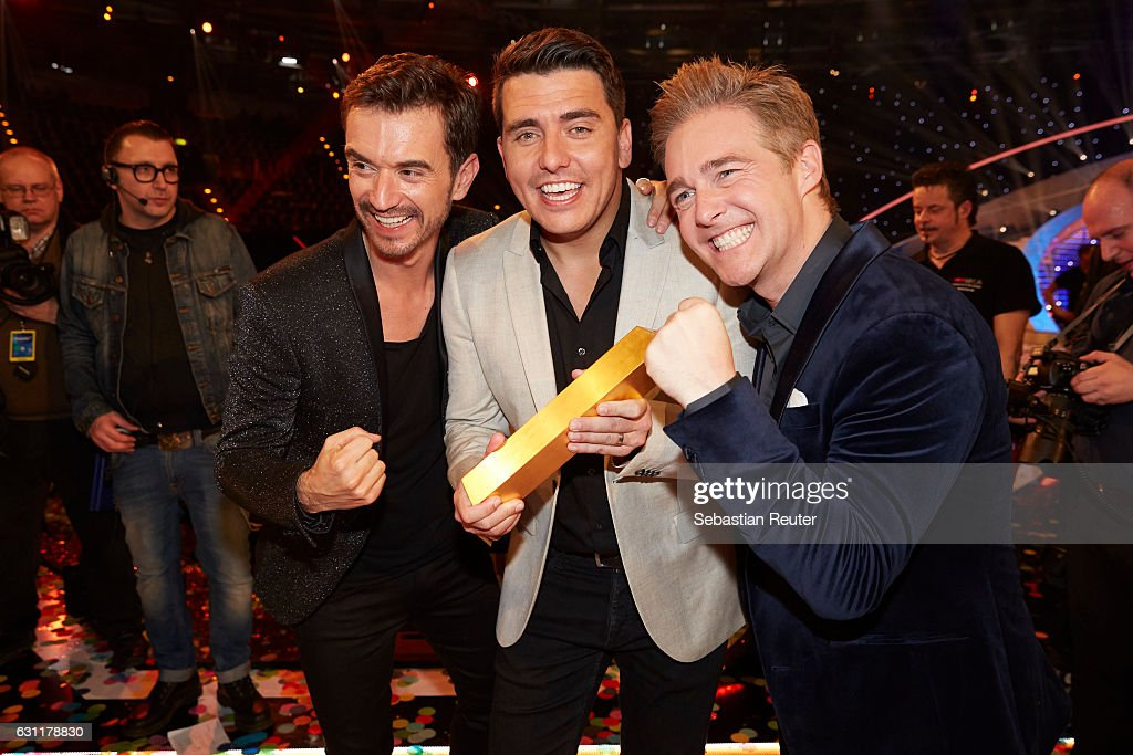 Florian Silbereisen, Jan Smit and Christoff de Bolle of Klubbb3 are seen on stage at the 'Das grosse Fest der Besten' tv show at Velodrom on January 7, 2017 in Berlin, Germany.