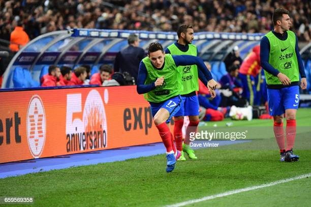 Florian Thauvin Dimitri Payet and Aymeric Laporte of France warm up during the friendly match between France and Spain at Stade de France on March 28...