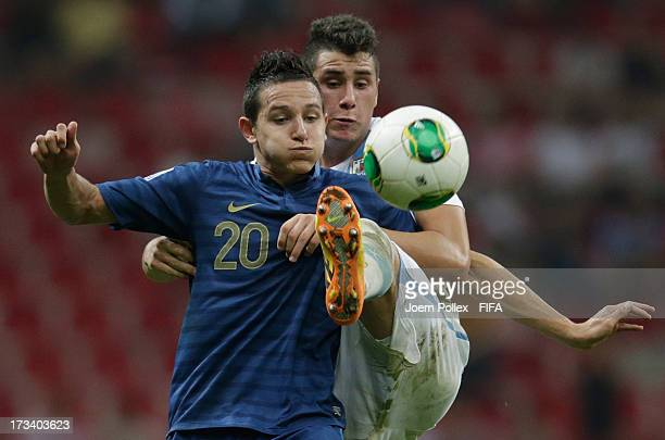 Florian Thauvin of France and Jose Gimenez of Uruguay compete for the ball during the FIFA U20 World Cup Final match between France and Uruguay at...
