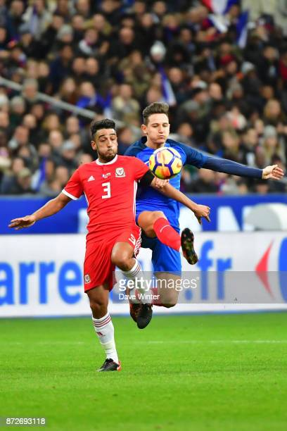 Florian Thauvin of France and Neil Taylor of Wales during the international friendly match between France and Wales at Stade de France on November 10...