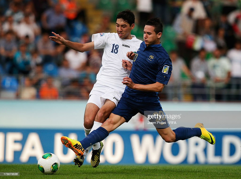 Florian Thauvin (R) of France and Sardor Sabirkhodjaev of Uzbekistan compete for the ball during the FIFA U-20 World Cup Quarter Final match between France and Uzbekistan at Yeni Sehir Stadium on July 6, 2013 in Rize, Turkey.