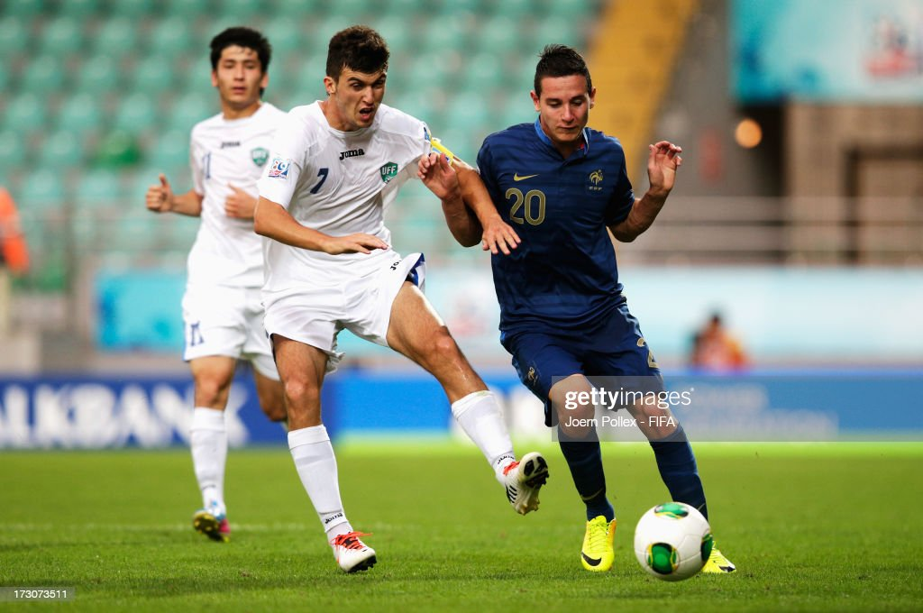 Florian Thauvin of France and Vladimir Kozak of Uzbekistan compete for the ball during the FIFA U-20 World Cup Quarter Final match between France and Uzbekistan at Yeni Sehir Stadium on July 6, 2013 in Rize, Turkey.