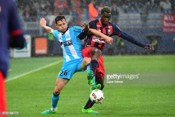 Florian Thauvin of Marseille and Yann Karamoh of Caen during the French Ligue 1 match between Caen and Marseille at Stade Michel D'Ornano on April 30...