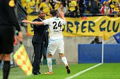 Florian Thauvin of Marseille celebrates after scoring his goal with Coach Franck Passi during the semifinal French Cup between Sochaux and Olympique...