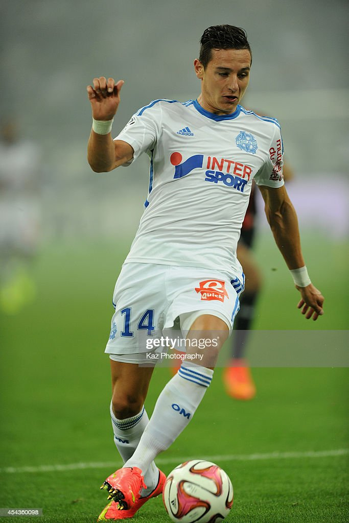 <a gi-track='captionPersonalityLinkClicked' href=/galleries/search?phrase=Florian+Thauvin&family=editorial&specificpeople=9157453 ng-click='$event.stopPropagation()'>Florian Thauvin</a> of Marseille in action during the French Ligue 1 match between Olympique de Marseille and OGC Nice at Stade Velodrome on August 29, 2014 in Marseille, France.