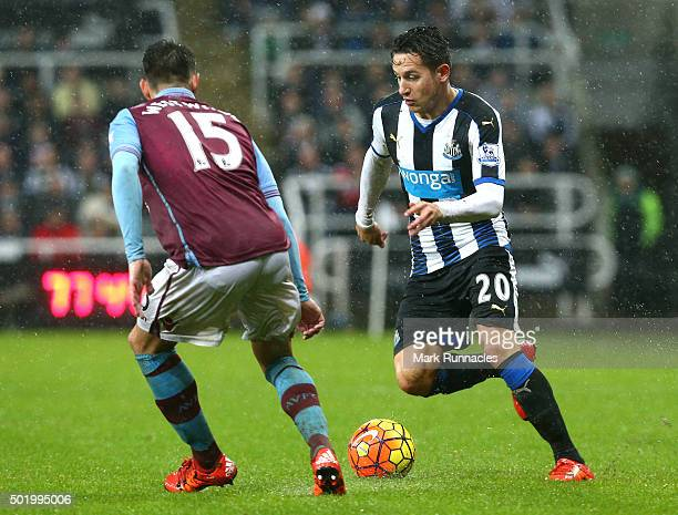 Florian Thauvin of Newcastle is challenged by Ashley Westwood of Aston Villa during the Barclays Premier League match between Newcastle United FC and...