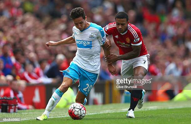 Florian Thauvin of Newcastle United and Memphis Depay of Manchester United compete for the ball during the Barclays Premier League match between...