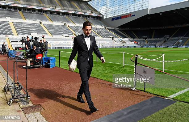 Florian Thauvin of Newcastle United arrives in a tuxedo for the Barclays Premier League match between Newcastle United and Arsenal at St James' Park...