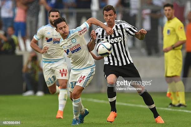 Florian Thauvin of Olympique de Marseille competes with Mario Mandzukic of Juventus FC during the preseason friendly match between Olympique de...