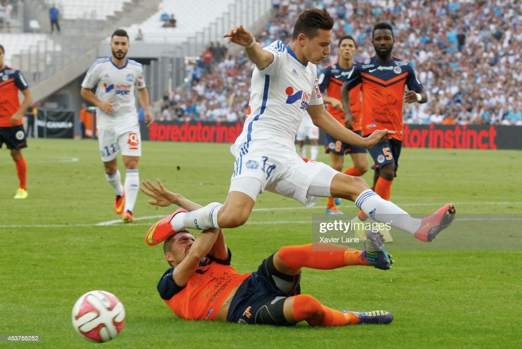 <a gi-track='captionPersonalityLinkClicked' href=/galleries/search?phrase=Florian+Thauvin&family=editorial&specificpeople=9157453 ng-click='$event.stopPropagation()'>Florian Thauvin</a> of Olympique de Marseille FC in action during the French Ligue 1 between Olympique de Marseille FC and Montpellier Herault FC at Stade Velodrome on August 17, 2014 in Marseille, France.