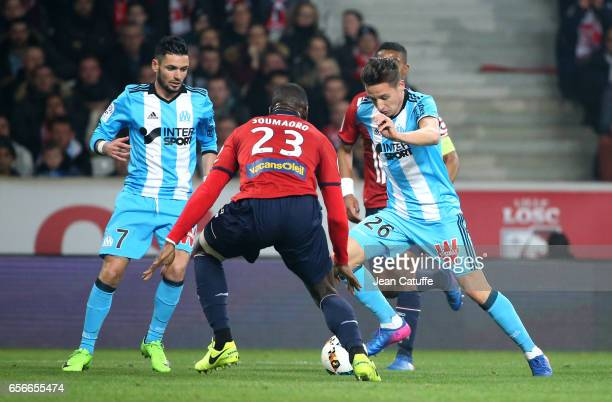 Florian Thauvin of OM and Remy Cabella of OM in action during the Ligue 1 match between Lille OSC and Olympique de Marseille at Stade PierreMauroy on...