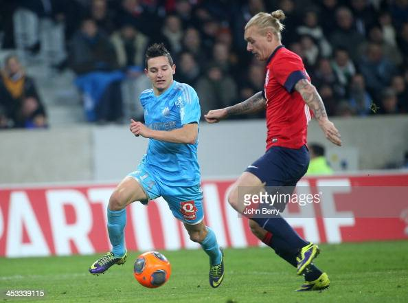 Florian Thauvin of OM and Simon Kjaer of Lille in action during the French Ligue 1 match between Lille OSC and Olympique de Marseille OM at the Grand...